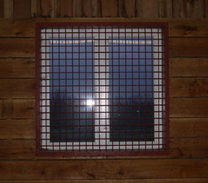 Window covered with steel grating